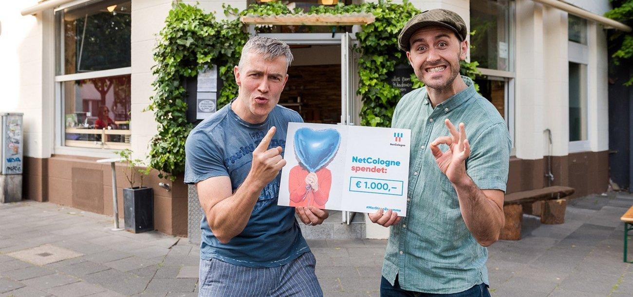 NetCologne überreicht eine Spende in Höhe von 1000 Euro an das Restaurant Bouschong.